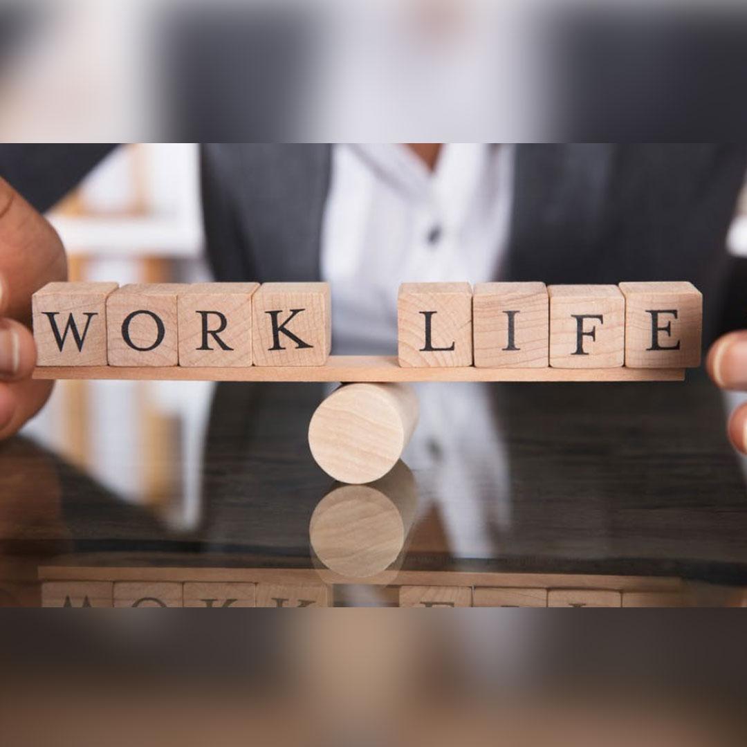 Work life words balancing on seasaw